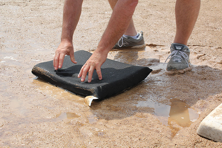 Gently press puddle sponge to absorb puddle water