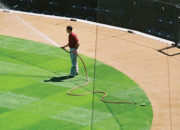 When hand watering is required, remove the cover and pull out the hose