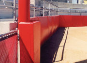 Protective padding enhances safety around light poles, backstops, and outfield walls.