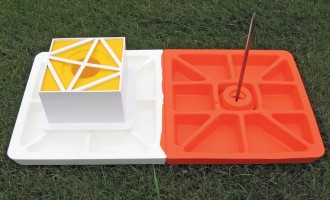 """7"""" Soft Touch stem under the white side of the base with a spike to stabilize the orange side"""