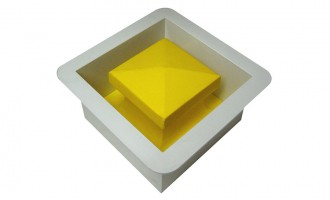 Tapered plug (yellow inner portion) and ground mount (white outer portion)