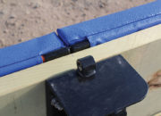 Clean top edge with built-in solid batten and net cable loop on the slide-over post bracket.