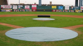 Yes, tarps will protect the mound and home plate from rain, but their primary function is to reduce evaporation.