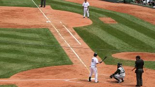 Three feet in foul territory and beginning halfway up the first base line, that's your runner's lane.